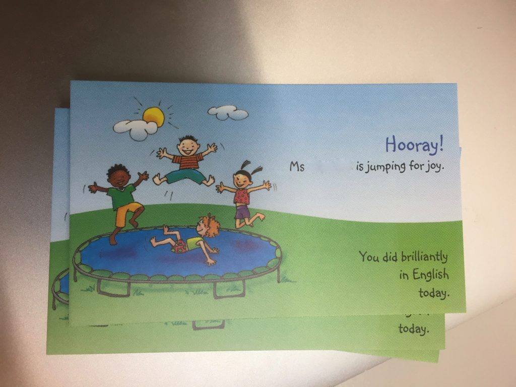 Card with 'Ms Jones is jumping for joy. Today you did brilliantly in English!
