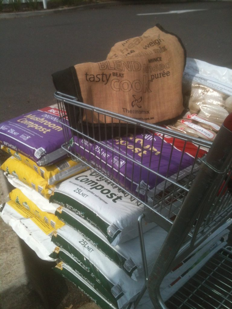 Shopping for compost to build up the soil.