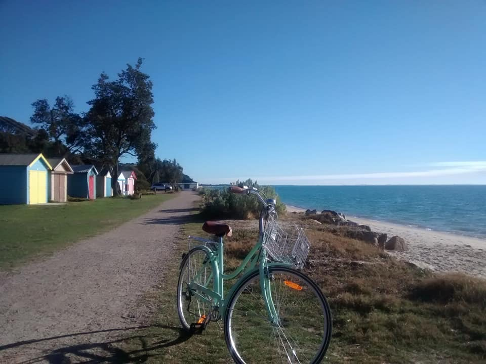 Biking near the bathing boxes at Portsea.