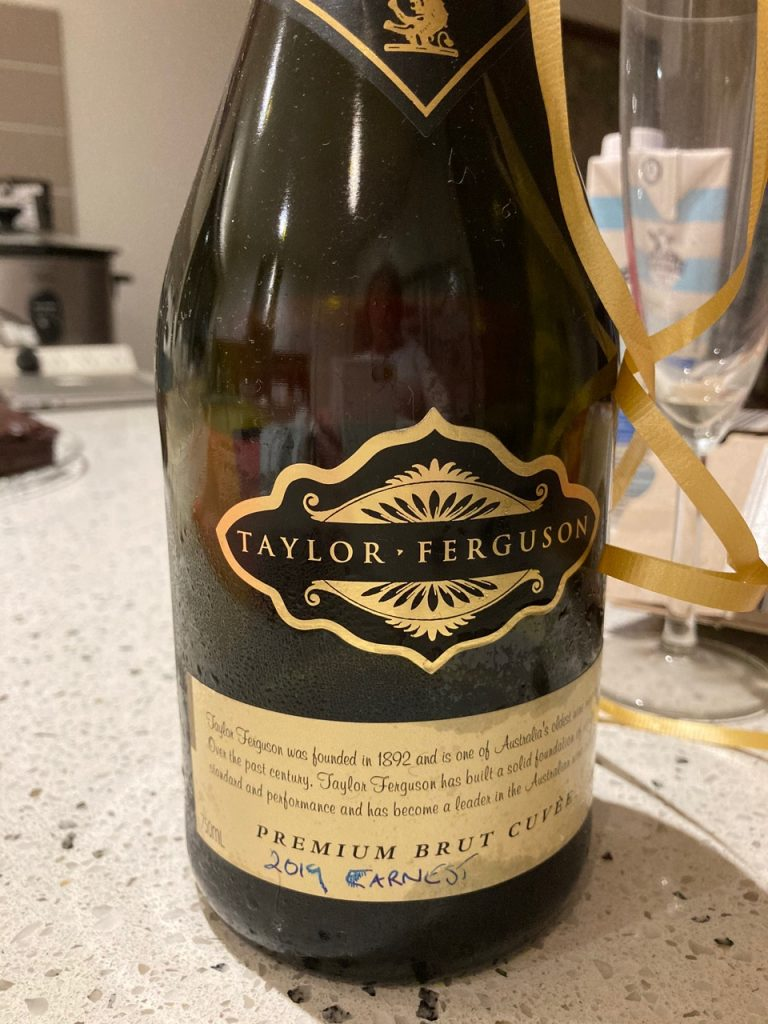 "Bottle of champagne with ""2019 EARNEST"" written on the label. My theatre students' gift."