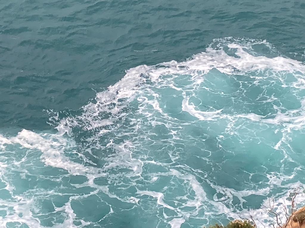 Waves hitting the beach.