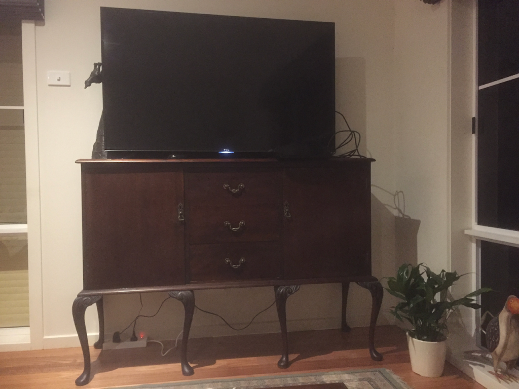 Cabinet with long spindly legs