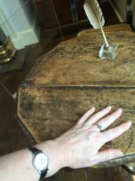 My hand on Jane Austen's writing table.