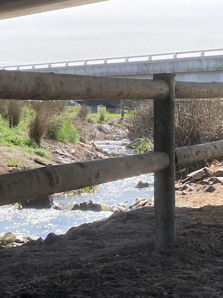 River under bridge.